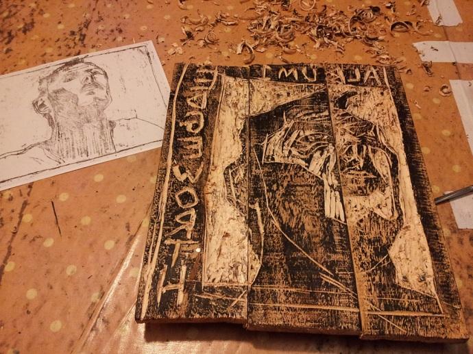 Edgeworth self-portrait inked wood carving