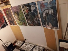 Upper row of oil paintings. Lower row of self-portrait woodcuts. All drying.