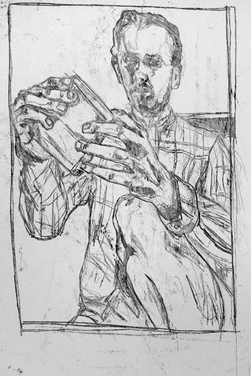 Self-portrait holding carving block