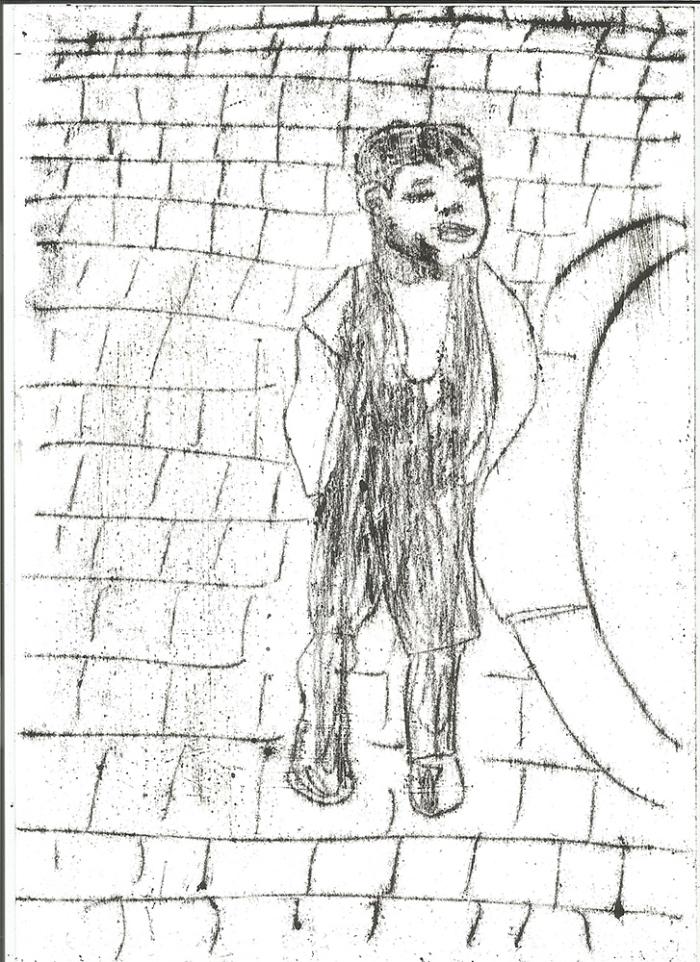 Boy by a kerb